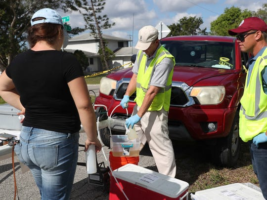 Employees of GFA International and the Department of Environmental Protection along with a geologist representing residents are taking water samples from ten wells surrounding and inside the toxic sludge site off of South Street in Fort Myers. The samples will be tested at separate sites.