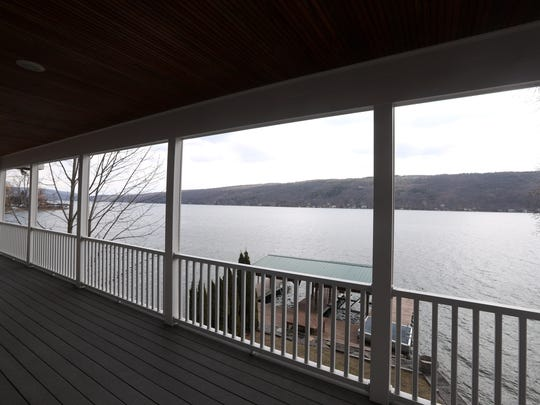 A porch overlooks Keuka Lake as part of this 3,700-square-foot home now available to rent.