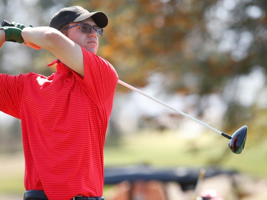 Chris Wardrup of Palm Desert High School fires a drive on the fifth hole at Classic Club Thursday in the DVL boys' individual championship.