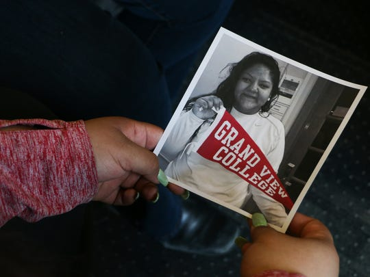 Giselle Sancen Valero holds a photo that was taken