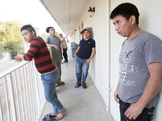 Migrant Guatemalan workers hang out in a balcony of