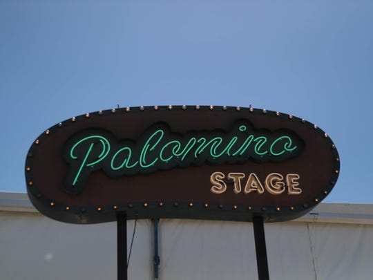 The Palomino stage sign hangs at the 2018 Stagecoach
