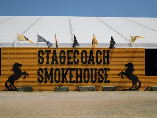 A sign hangs for the barbecue vendors at the Stagecoach