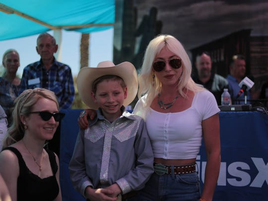 Mason Ramsey, aka Yodel Boy, poses for photos at the 2018 Stagecoach music festival.