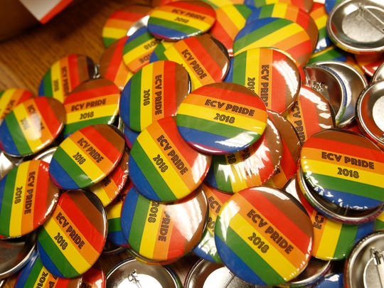 Volunteers create buttons to be worn at the second annual East Coachella Valley Pride event on Saturday April 28, 2018.
