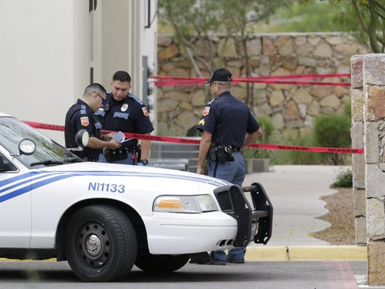 El Paso Police Department officers investigate a shooting