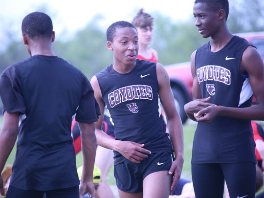 West Creek's track athletes gather in the infield prior