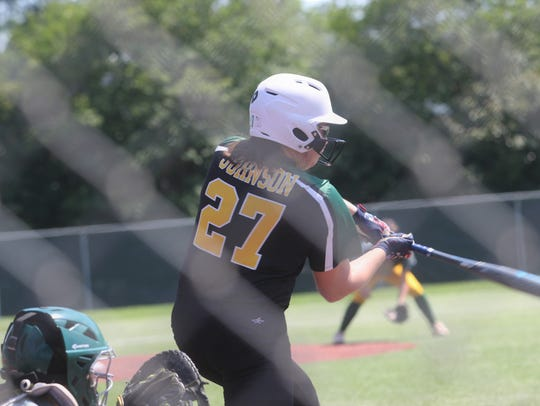 Menard's Olivia Johnson (27) blasts a three-run home