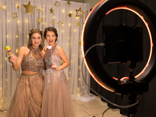 Rockport-Fulton High School students take a photo at their school's prom at La Palmera mall on Saturday, April 28, 2018.