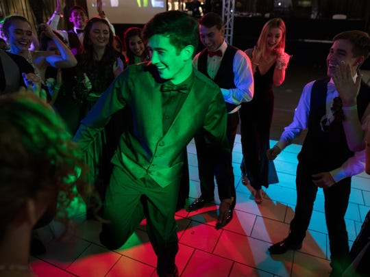 Rockport-Fulton High School students dance during their school's prom at La Palmera mall on Saturday, April 28, 2018.