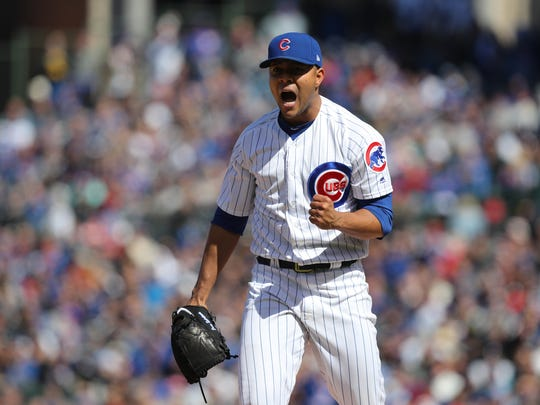 Cubs starting pitcher Jose Quintana celebrates after