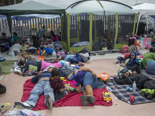Central American migrants camped out after being turned away
