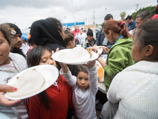 "Central American children are fed first before adults at their encampment at the entrance of the ""El Chaparral' U.S. point of entry in Tijuana, Mexico on May 1, 2018."