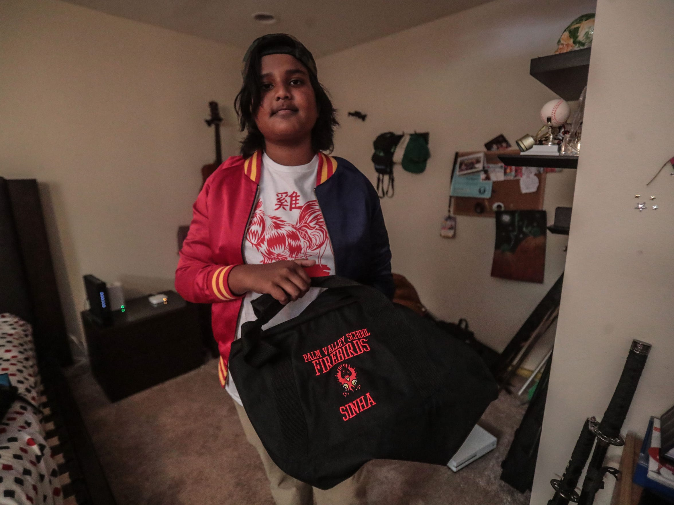 Sid Sinha shows is Palm Valley private school bag at his home in Thousand Palms on Tuesday, May 1, 2018.