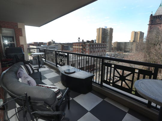 The view from this condo terrace in Sagamore on East overlooks East Ave. This unit is priced at $695,000.