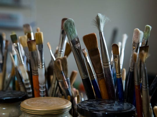 Gary Hartenhoff's paint brushes are shown in his art studio in Sioux Falls, S.D. on Wednesday, May 2, 2018. Hartenhoff died last week at the age of 82.