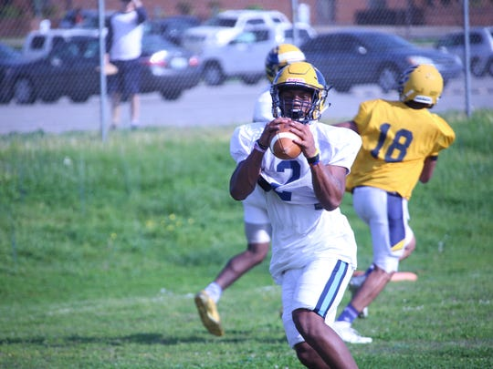 Northeast's Fred Orr catches a pass during spring football drills Wednesday at Northeast High School. Orr transferred from Rossview after finishing his junior season with the Hawks last fall.