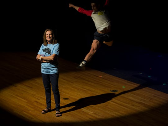 """North Fort Myers High School teacher Michele Whitener, is retiring from teaching after 40 years. Trevor Michael Schmidt, 23, in background, is her former student and currently performs with national tour of the musical """"A Chorus Line."""""""