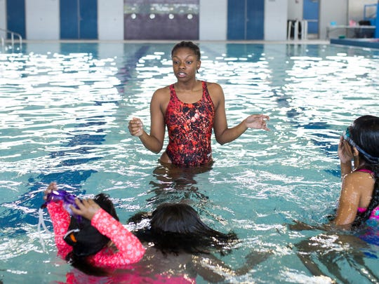Darienne Parris, 16, works with kids on their swimming on Thursday, May 3, 2018 at the Corpus Christi Natatorium.