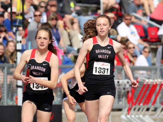 Krista Bickley of Brandon Valley completes the handoff