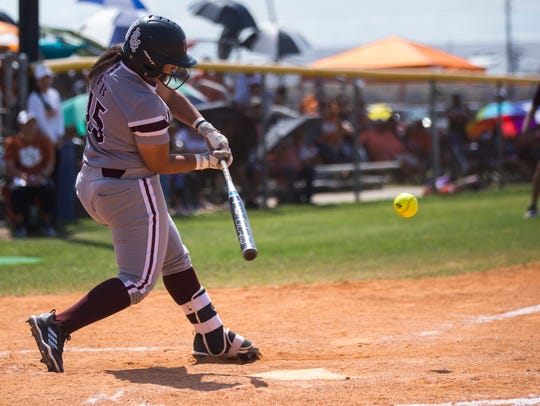 Flour Bluff's Araya Ayala hits the ball during their