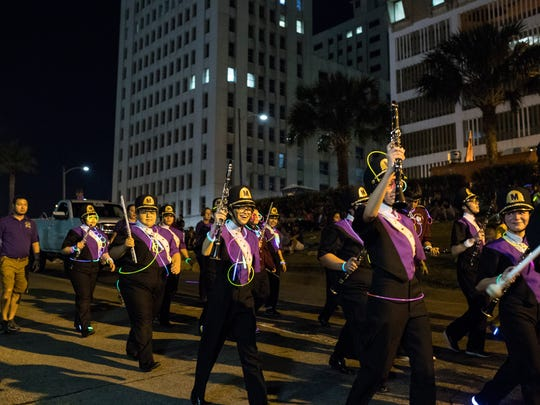 Miller High School band members march during the 2018 Buc Days Illuminated Night Parade on Saturday, May 5, 2018, on Leopard Street in downtown Corpus Christi.