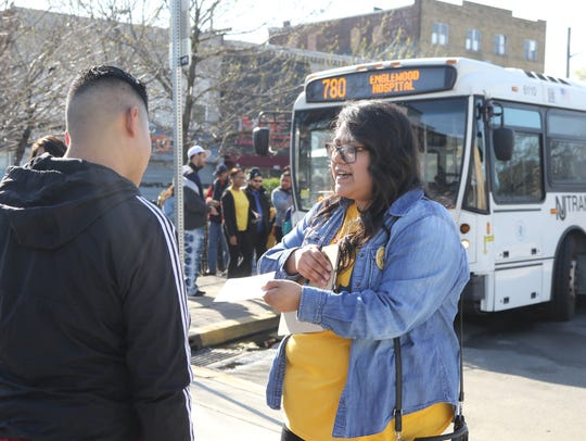 Ruth Delgado of Make the Road NJ gathered signatures at a bus stop in Passaic in May in support of a bill to let unauthorized immigrants obtain driver's licenses.