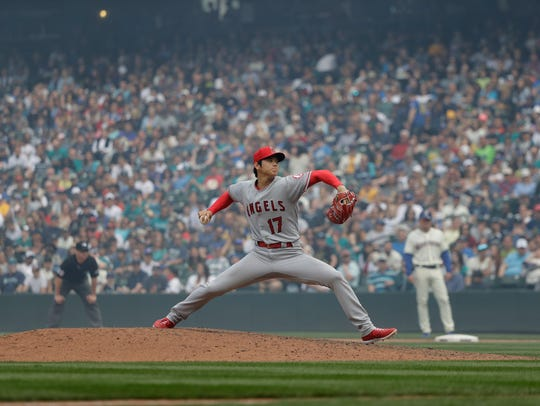 Los Angeles Angels starting pitcher Shohei Ohtani throws