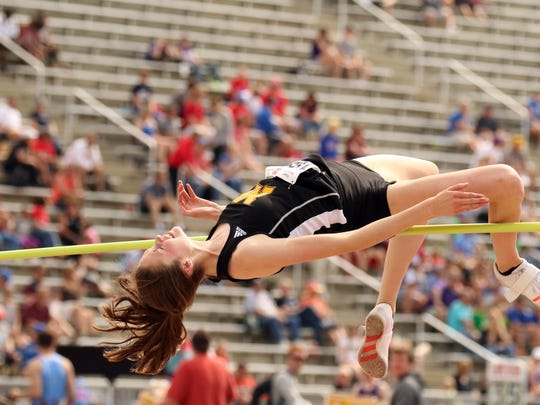 """Carly Haring of Mitchell clears 5' 6"""" to win the HS"""