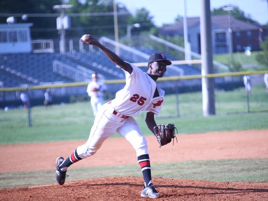 Rossview's Elijah Pleasants hurls a pitch toward home plate against Northwest during their district tournament Monday at Northwest.