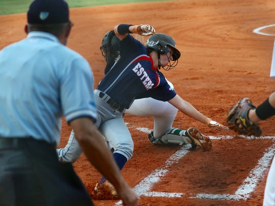 Estero's Lauren Hobbs scores the first run against Fort Myers High during a Class 7A softball regional semifinal last May.