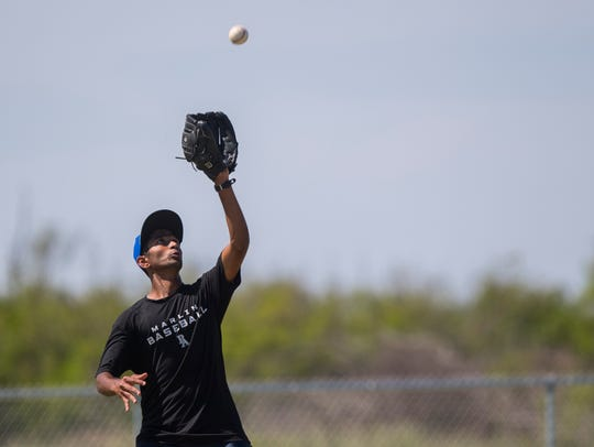 Port Aransas' Haridev Desai practices with his team
