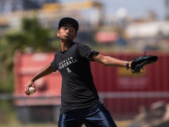 Port Aransas' Haridev Desai practices with his team on Tuesday, May 8, 2018 at Community Park in Port Aransas.