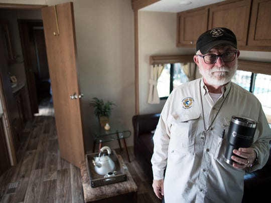 Alan Graham founder of Community First! Village stands in a RV available for rent to chronically homeless in Travis County Texas.