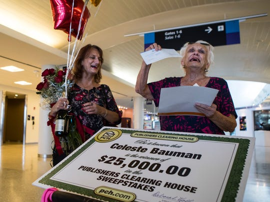 Carol Olivier (left) and her mother Celeste Bauman open the check from Publishers Clearing House on Friday, May 11, 2018 at Corpus Christi International Airport.