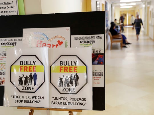 Signs promote a bully-free environment at the On Lok 30th Street Senior Center in San Francisco.