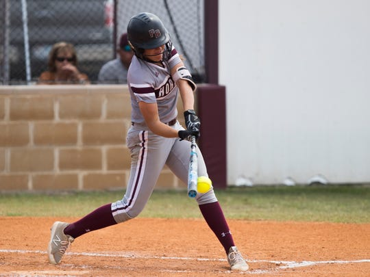Flour Bluff's Riley Grunberg hits the ball against