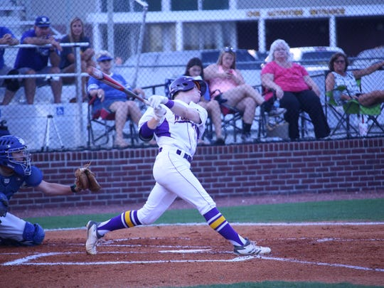 Clarksville High's Garrett Spain swings and connects