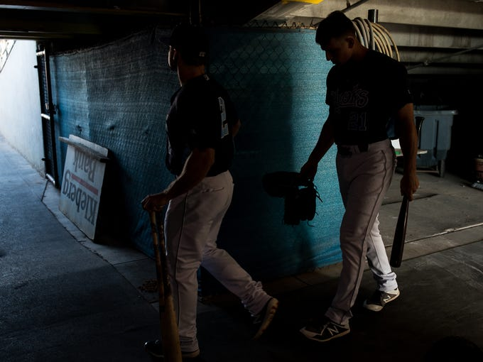 Hooks' players walk out of their tunnel to on to Whataburger