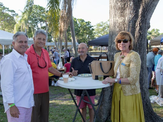 """Loren Coyle, left, Chris Lecakes, Chris Luciano and St. Francis Manor board member Gladys LaForge enjoy a drink at the St. Francis Manor """"All American Country BBQ Bash"""" April 28."""