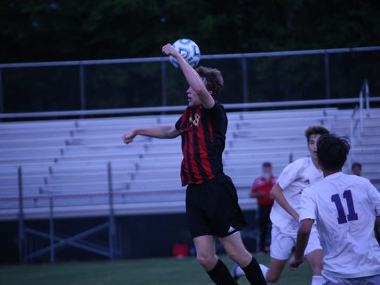 Rossview's Blake Campbell heads the ball forward to