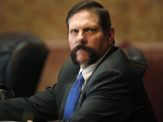 In this Monday, April 2, 2018, file photograph, Colorado State Senator Randy Baumgardner, R-Hot Sulphur Springs, looks on during a debate on the chamber's floor about a Democratic resolution calling for Baumgardner's expulsion in the State Capitol in Denver. Baumgardner is accused of inappropriately touching a former legislative aide.