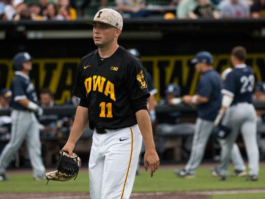 Iowa pitcher Cole McDonald walks off the mound during