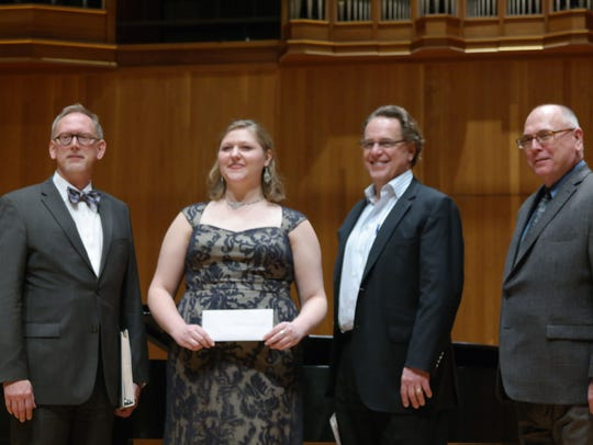 Pictured are, from left, Greg Carpenter, director of Opera Colorado; Jessica Faselt; Ward Holmquist, former artistic director of Lyric Opera Kansas City; and Gerald Dolter, director of Texas Tech University Music Theatre. Faselt competed Jan. 11, 2014 in the Metropolitan Opera District Council Auditions in Ames and was chosen as one of three winners.