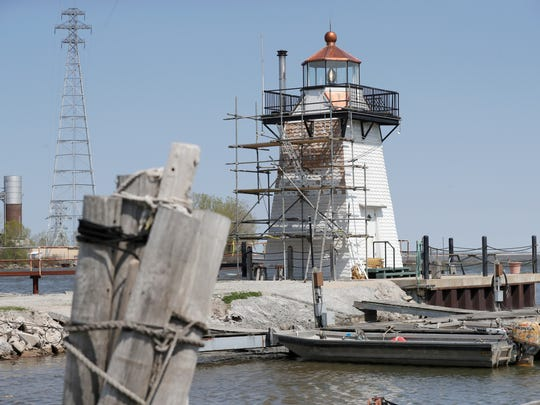 The north Grassy Island Range Lighthouse at the Green Bay Yachting Club which is undergoing exterior renovation Tuesday, May 15, 2018 in Green Bay, Wis
