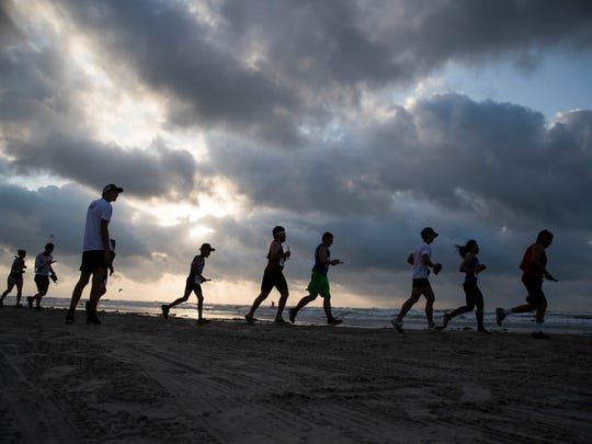 Runners participate in the 43rd annual Beach to Bay relay marathon on Saturday, May 19, 2018 in Corpus Christi.