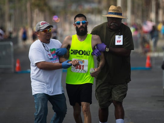 Medical staff tend to runners that participated in the 43rd annual Beach to Bay relay marathon on Saturday, May 19, 2018 in Corpus Christi.