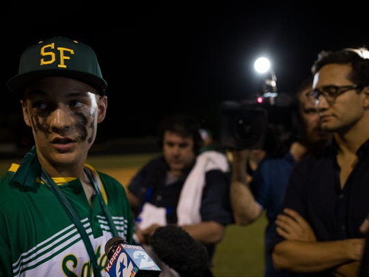 Santa Fe's Trenton Beazley, who was injured in Fridays shooting talks to the media after their playoff game against Kingwood Park at Dear Park Junior High School on Saturday, May 19, 2018.
