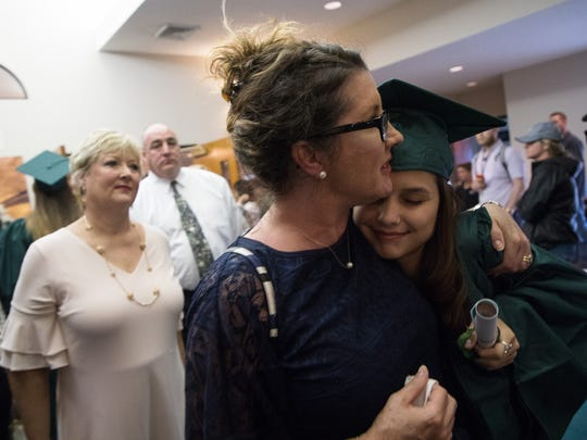 A women hugs her daughter after the Santa Fe High School class of 2018 Baccalaureate Ceremony at the Arcadia First Baptist Church in Santa Fe, Texas, on Sunday, May 20, 2018. The ceremony was moved from the school's auditorium after a shooting that killed 10 two days earlier.