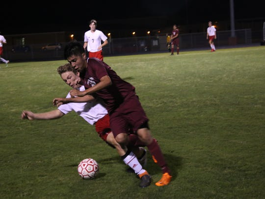 A Rossview and Kingsbury player collide after chasing down the ball during their Class AAA soccer sectional game Saturday night at Rossview High. The Hawks beat Kingsbury 3-1 to advance to the program's first state tournament.
